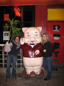 Us, the plant, a pig, and the people peaking through the restaurant window.